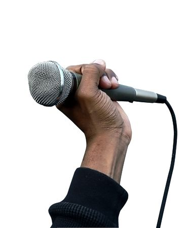 spoken: photo of a hand holding a vocal microphone over white background