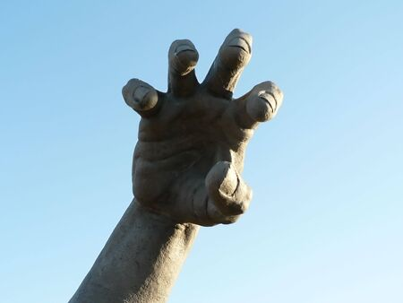 photo of a isolated close up shot of a hand of a statue