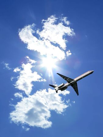 commercial jet in flight just after takeoff with a bright blue sky in the background. copy space included