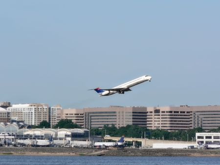 commercial jet in flight just after takeoff from Reagan National Airport in Washington, DC. copy space included Stock Photo