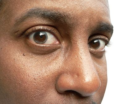 three quarter view close up of a african american males eyes