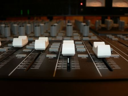 master volume: photo of channel volume controls of a recording studio mixing console Stock Photo