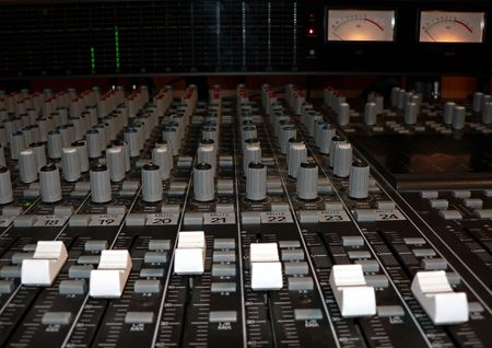 photo of a recording studio mixing console