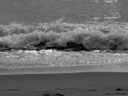 va: ocean waves crashing in the surf at VA Beach in the early morning Stock Photo