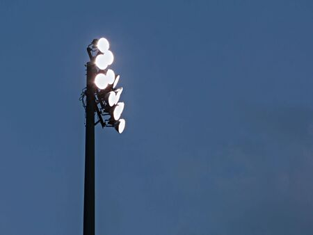 stadium lights: isolated sideview of a high schools stadium lights at dusk