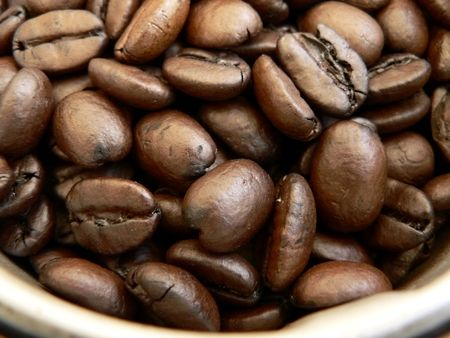 close up of whole roasted coffee beans in a grinder Reklamní fotografie