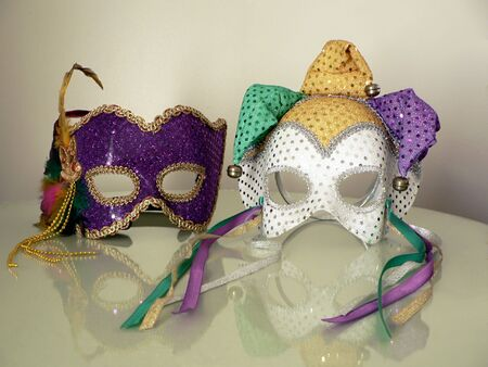a pair of carnival mask on glass