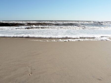 photo of a foamy surf on Virginia Beach that includes copy and crop space Stock Photo