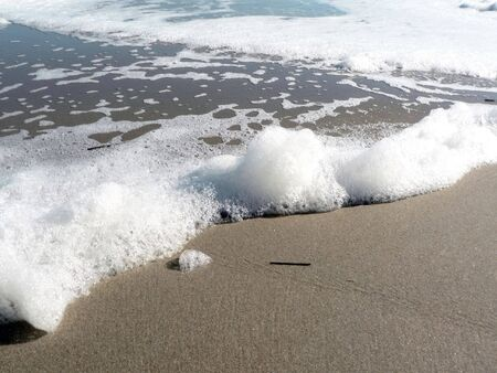 photo of a foamy surf on Virginia Beach that includes copy and crop space Stock fotó