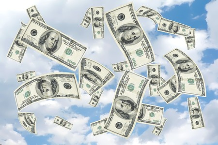 concept image with copy and cropping space depicting a money shower of 100 hundred dollar bills falling from a cloudy blue sky