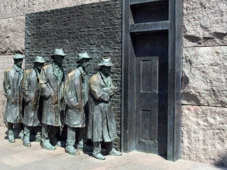 district columbia: statues of unemployed men standing in a unemployment line during the Great Depression at the FDR Memorial in Washington, D.C.