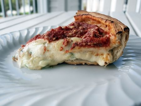 a deep crust Chicago style stuffed pizza slice Stok Fotoğraf