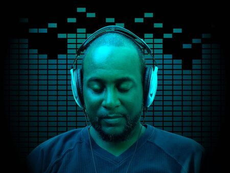 forty something: concept photo of a forty something year old african american man wearing headphones while listening to music with equalizer spectrum in the background