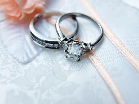 photo of a diamond & platinum wedding ring on a photo album
