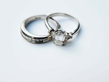 photo of a diamond & platinum wedding ring on a white background
