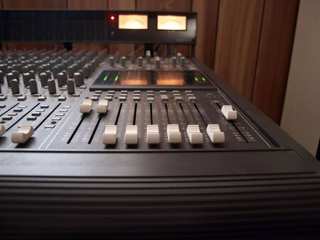 photo of channel volume controls of a recording studio mixing console Stok Fotoğraf - 5602713