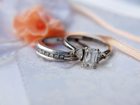 photo of a diamond & platinum wedding ring on a photo album