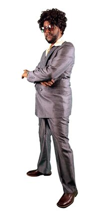 a man dressed in a retro 70s pimp styled attire ready for the club or party scene isolated on a white background