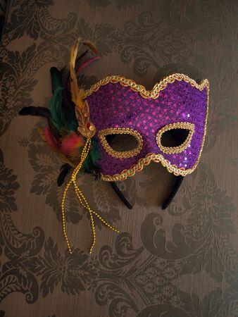 carnival mask on decorative fabric photo