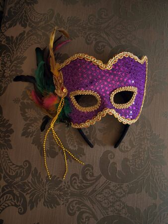 costume ball: carnival mask on decorative fabric Stock Photo