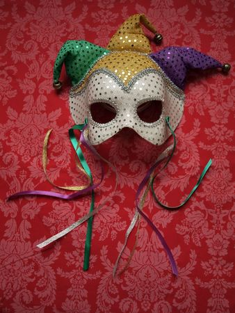 venice: carnival mask on decorative fabric Stock Photo