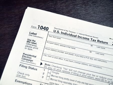 US 1040 Income Tax Form for tax preparation and accounting services related subject matter. Imagens