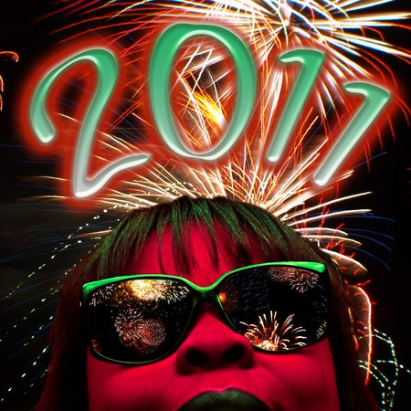 portait: stylized facial portait of a red faced female with fireworks and 2011 text over head to represent a new year Stock Photo