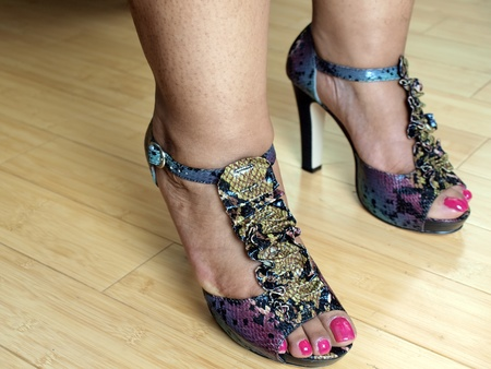 feet of a african american womans feet in fashionable open toe high heel shoes photo