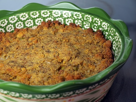 homemade baked cornbread stuffing in a green ceramic bowl