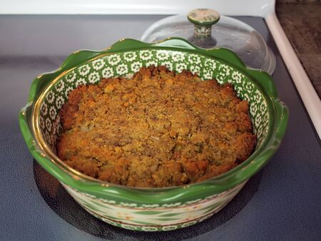 stuffing: homemade baked cornbread stuffing in a green ceramic bowl