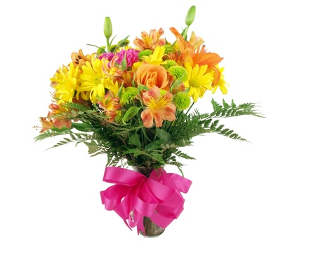 a colorful flower bouquet in a clear glass vase on a white background