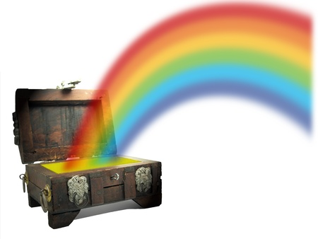 Conceptual image of a miniature wooden pirate treasure chest with a rainbow beaming out of it to depict wealth and prosperity.