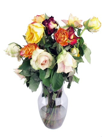 a bouquet of wilted roses in a clear glass vase