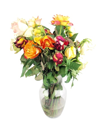 vase: a bouquet of wilted roses in a clear glass vase