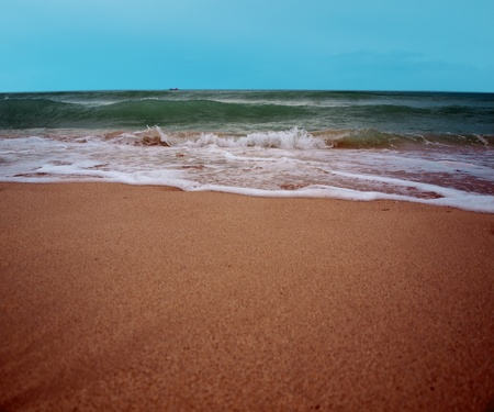 ocean waves crashing on the surf of South Beach photo