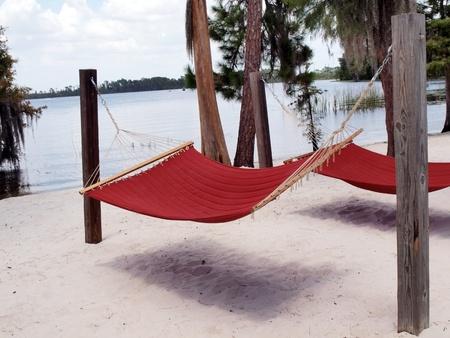 red hammocks on a Florida lake beach of white sand