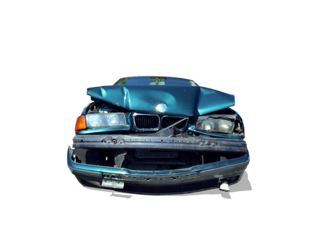 front profile of a wrecked automobile isolated on a white background