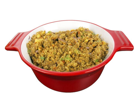 cornbread: cornbread stuffing in a red cooking bowl isolated on white background