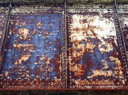 close up photo of painted distressed metal of a bridge