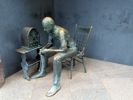 statue of man listening to a radio at the FDR Memorial in Washington, D.C.