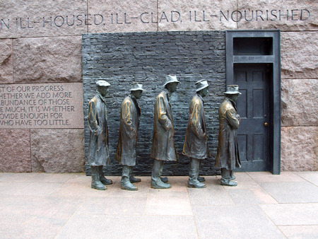 statues of unemployed men standing in a bread line during the Great Depression at the FDR Memorial in Washington, D.C. Stock fotó