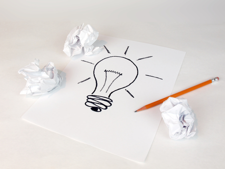 creative idea: creative idea concept for business and intellectual layouts featuring an idea lightbulb with crumbled paper and pencils Stock Photo