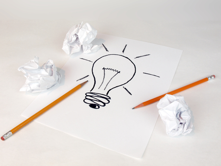 creative idea concept for business and intellectual layouts featuring an idea lightbulb with crumbled paper and pencils Stock fotó