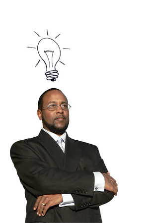 photo collage concept of a african american business man in deep thought with a illustrated idea bulb to depict a great idea