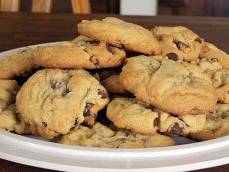 fresh baked: homemade chocolate chip cookies fresh baked on a serving tray Stock Photo