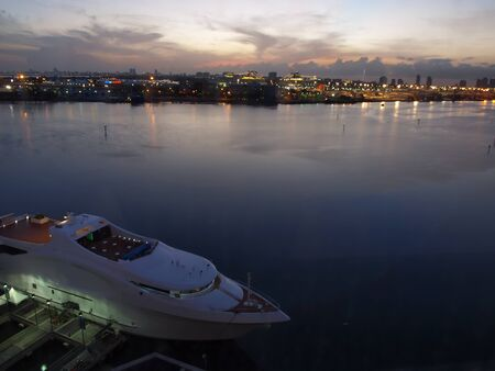 south beach: Biscayne Bay at dusk with the Port of Miami and South Beach in the background.