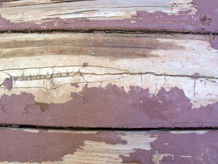 close up photo of  weather beaten painted old wood beams