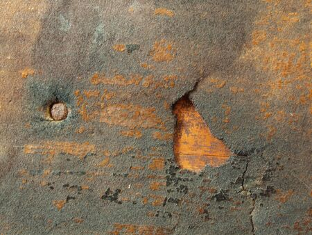 weather beaten: close up photo of a section of a antique chest
