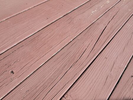 weather beaten: close up photo of  weather beaten painted old wood beams of a deck