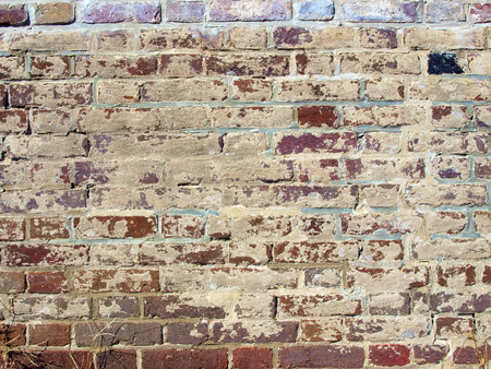 photo of an antique brickwall showcasing its weathered and appearance and texture Stok Fotoğraf